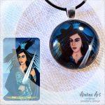 Queen of Swords art pendant displayed with tarot artwork
