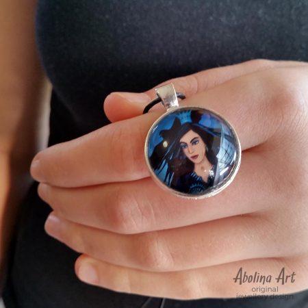 Queen of Swords pendant held by model