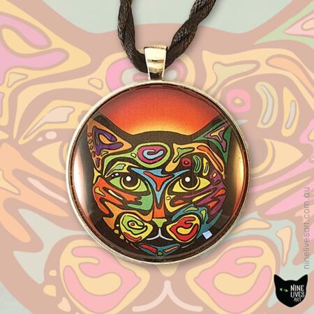 Bright and colourful cat pendant in 40mm cabochon setting