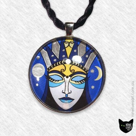 Large moon goddess pendant with silver enamel in 40mm glass cabochon setting, strung on black cord