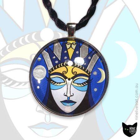 Art pendant featuring inward reflecting moon goddess on deep blue background 40mm diameter