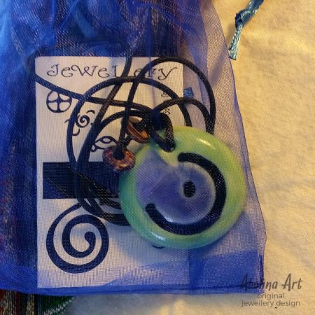 Moon pendant in bag with symbol card