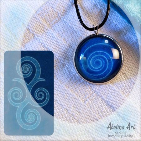 Nine Lives blue spiral pendant with back of tarot card as art reference
