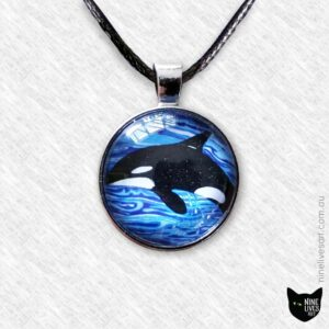 Orca swimming in blue waves 25mm art pendant strung on cord