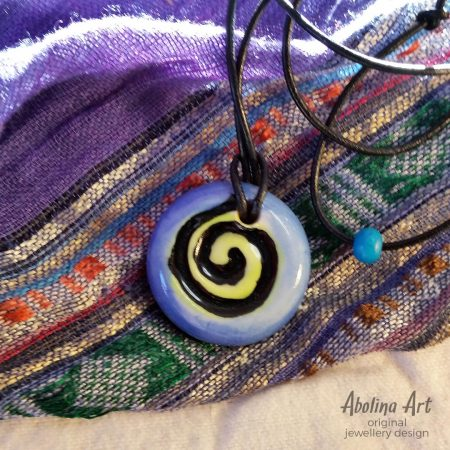 Small Spiral pendant blue citrus and black strung on leather cord