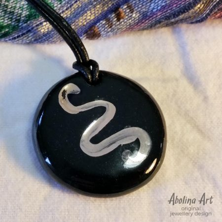 Snake Lustre on Black 35mm round stoneware pendant strung on leather cord
