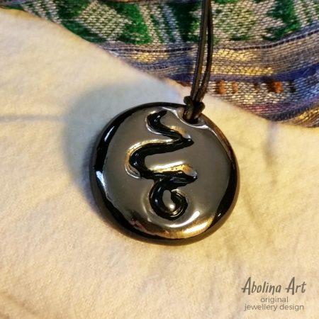 Platinum lustre stoneware snake pendant
