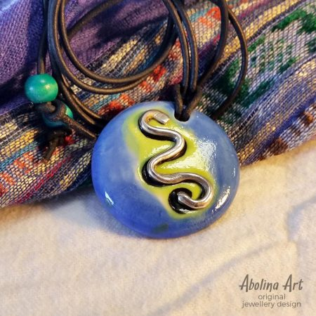 Blue stoneware pendant with silver snake
