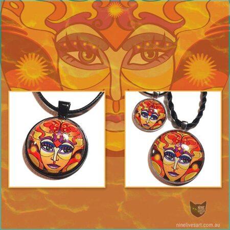 Sun Goddess art pendants displayed on background of original artwork in warm orange tones