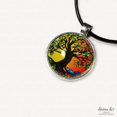 Tree of Life glass pendant 25mm with antique silver metal backingstrung on black cord