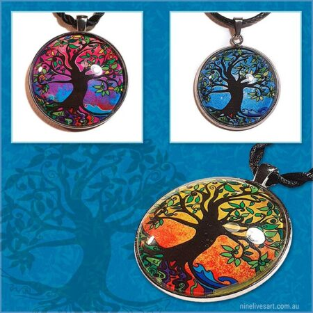 Tree of life pendants featuring original and colourful artwork sealed under glass cabochon and strung on cord for wearing