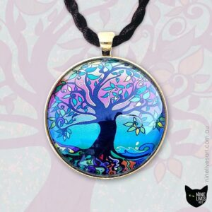 Psychedelic Dawn 40mm pendant on backdrop featuring enlarged tree artwork