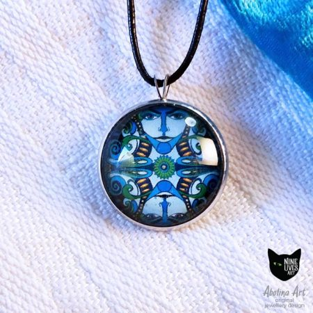 Lumino art pendant blue faces 25mm glass dome pendant strung on black cord