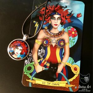 25mm art pendant depicting the Chariot from Nine Lives Tarot, displayed with original artwork