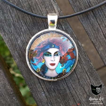 25mm pendant featuring the chariot from Nine Lives Tarot cabochon and antique silver metal setting