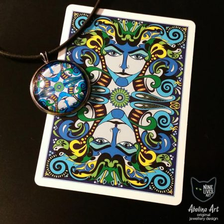 Art pendant displayed playing card showing connection to artwork