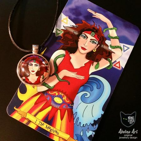 art pendant featuring female archetype Magician from Nine Lives Tarot placed over (detail) original artwork