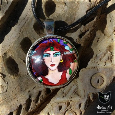 pendant necklace featuring the magician from Nine Lives Tarot