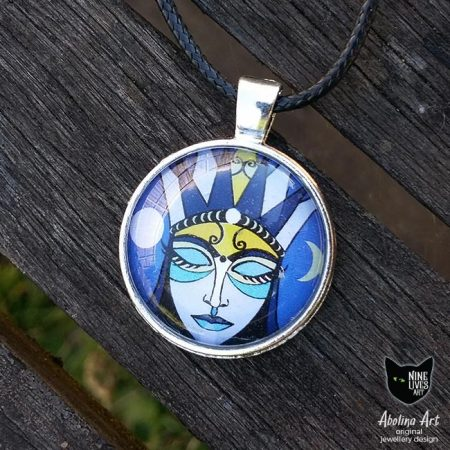 Moon Goddess artwork in 25mm cabochon and antique silver setting. Artwork in blue hues featuring woman with eyes closed