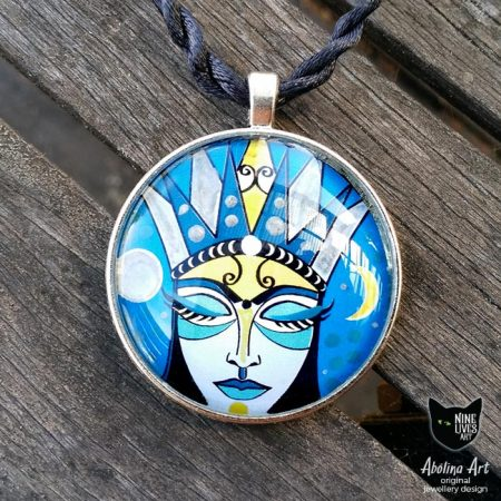 Moon Goddess 40mm art pendant photographed in full sun