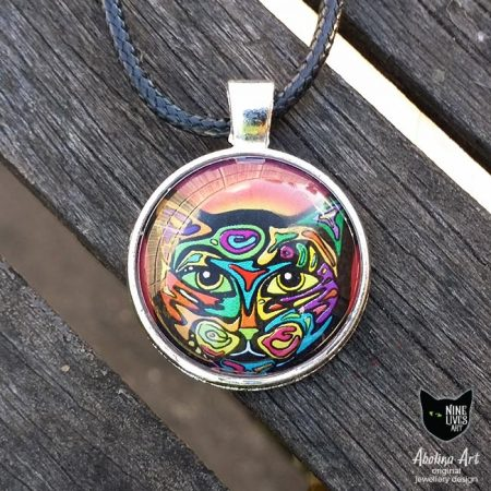 Boldly painted cat in psychedelic colours original art pendant set under glass cabochon in antique silver metal tray with black cord for wearing