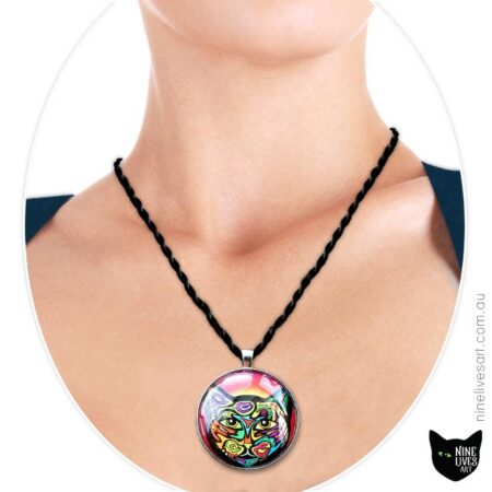 Model wearing 40mm art pendant Psychedelic Cat in bright colours