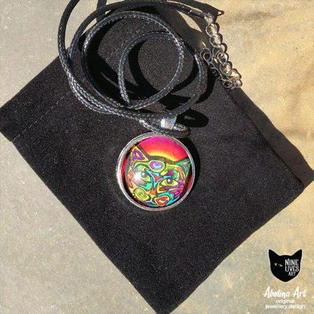 25mm art pendant Psychedelic Cat placed on black velvet gift bag