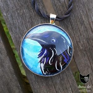 Art pendant 40mm black raven painted with silver enamel strung on twisted silk cord