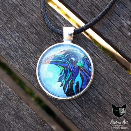 25mm art pendant featuring head of raven sealed under glass dome with antique silver metal back