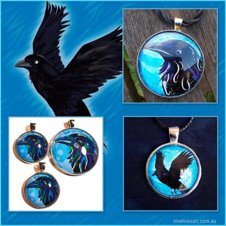 Raven art pendants depicted on blue background featuring a flying black raven