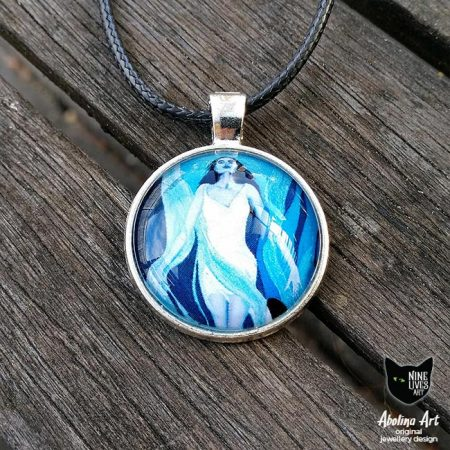 Rejuvenation rising up from ocean depths artwork in blue hues set in 25mm cabochon on antique silver back