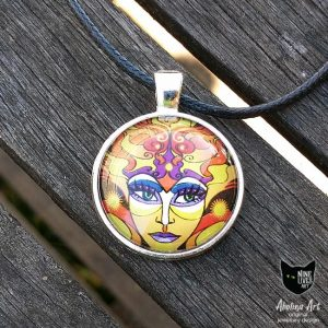 25mm sun goddess art pendant featuring artwork in warm yellow orange hues