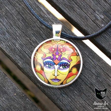 25mm sun goddess art pendant featuring artwork in warm yellow orange hues