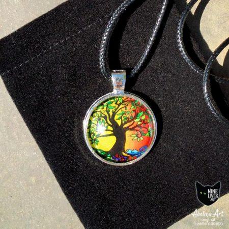 Tree of Life art pendant placed on black velvet gift bag