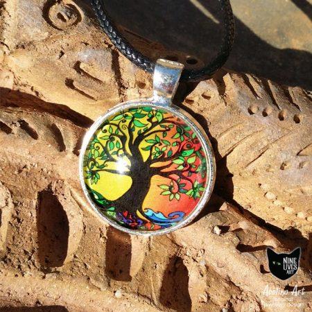 Tree pf Life Summer 25mm art pendant photographed in full sun on terracotta background