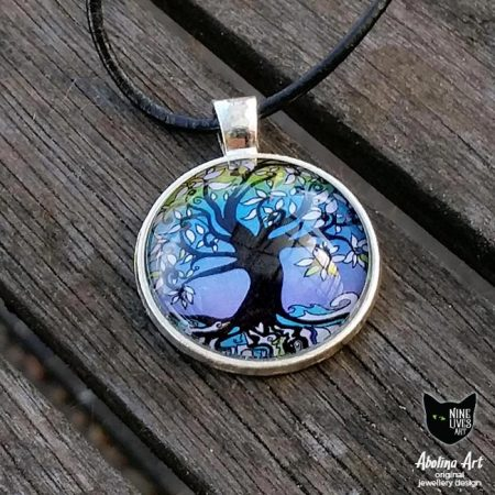 Tree of life winter art pendant set in cabochon and antique silver metal