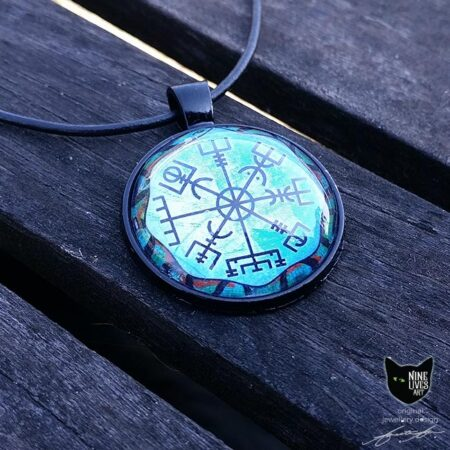 Norse wayfinder symbol featured on this cabochon art pendant strung on black cord