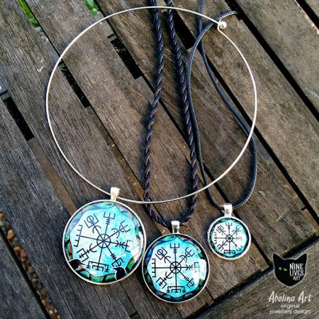 Collection of three Vegvisir pendants in different sizes