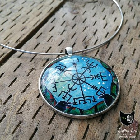 Art pendant featuring Norse inspired symbols original artwork and enamel paint sealed under glass cabochon