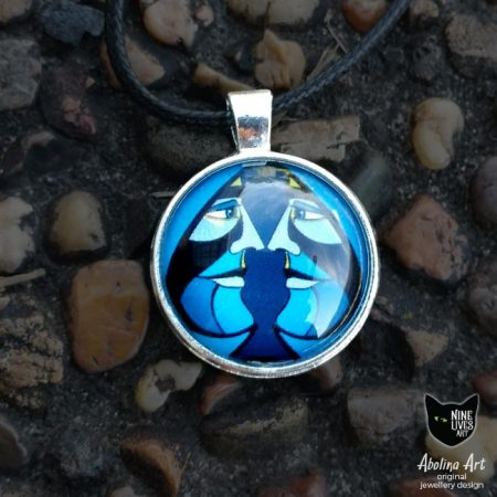 Ace of Spades necklace pendant featuring mirrored faces in blue