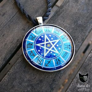 Blue pendant with zodiac artwork featuring star signs on blue with pentagram in centre