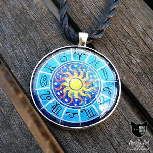 Pendant featuring star signs on blue background with bright sun in centre