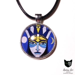 Moon Goddess looking ahead on blue background - artwork sealed under glass cabochon, original and handmade jewellery design