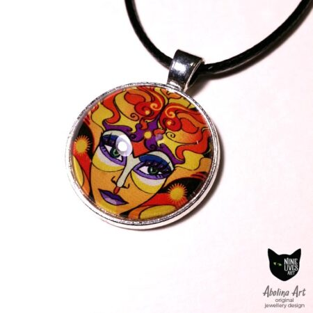 Sun Goddess art pendant smaller size on antique silver metal backing, strung on black cord