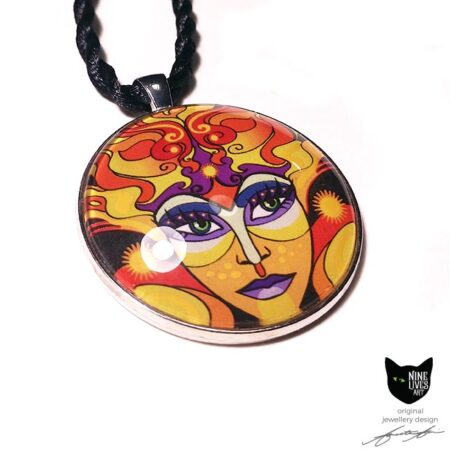Sun Goddess artwork sealed under glass cabochon with antique silver metal pendant backing and twisted silk cord