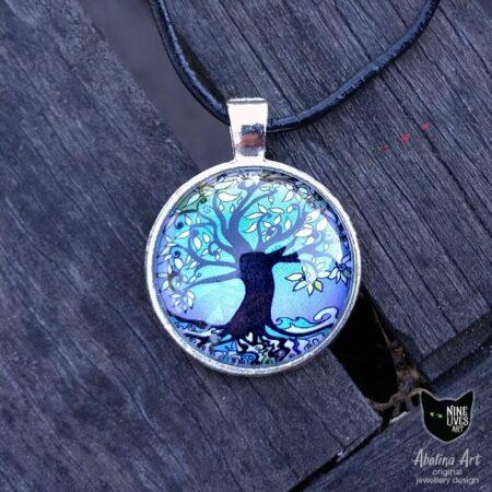 Original cabochon art pendant featuring tree of life clad in purple winter colours