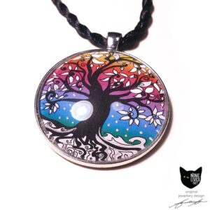 Tree of Life artwork white leaves and snow representing winter with painted silver enamel sealed under the cabochon, striking original jewellery design