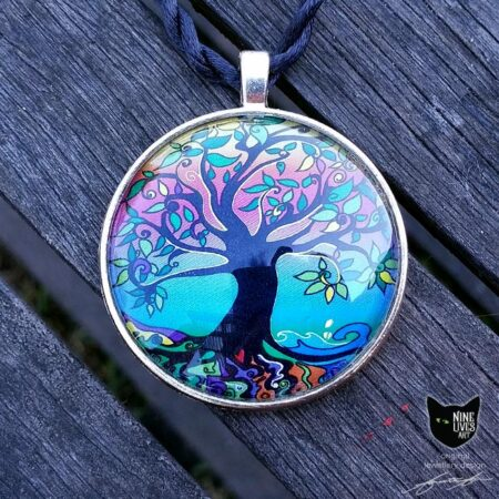 Tree of Life in psychedelic dawn colours, artwork sealed under glass cabochon set in antique silver metal backing and strung on twisted silk cord
