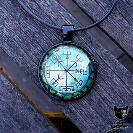 Vegvisir wayfinder symbol artwork sealed under glass cabochon on black backing with cord