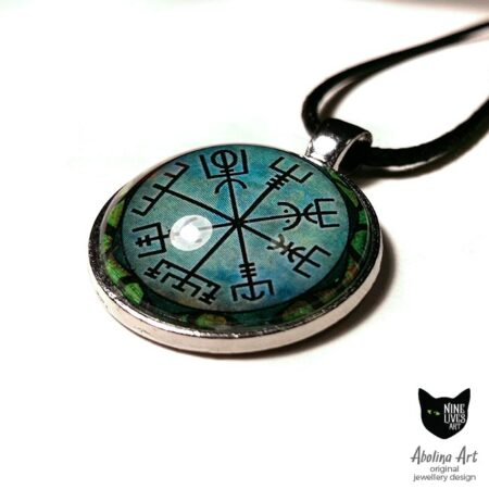 close up view of green vegvisir symbol on 25mm art pendant sealed under glass cabochon